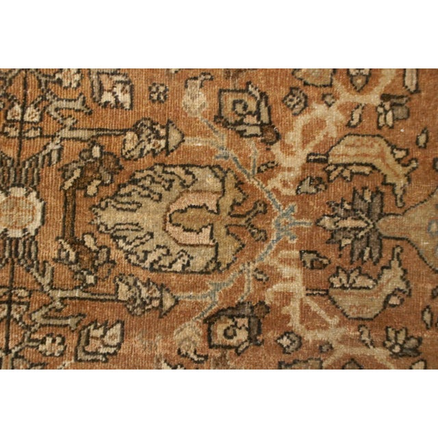 An amazing early 20th century Persian Mahal Sultanabad rug with an intricately woven floral pattern on a natural, undyed,...