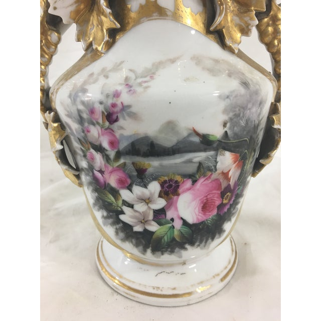 This Old Paris vase has some of the finest decoration we've seen--the painted flowers and the gilding are truly exquisite....