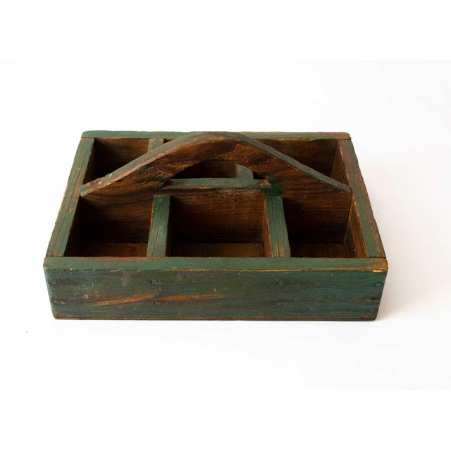 A vintage berry carrier in deep forest green. Perfect for organizing kitchen utensils or storing entry way necessities...
