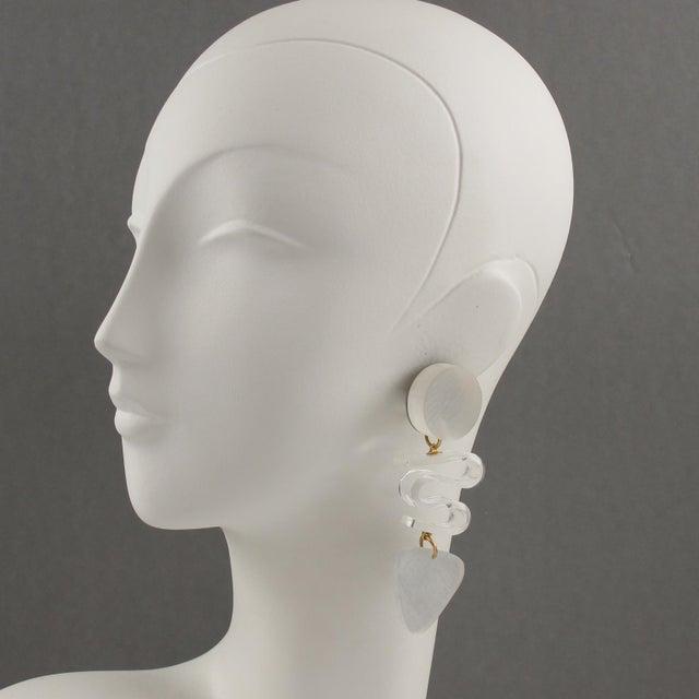 Stunning oversized Lucite clip on earrings designed by Harriet Bauknight for Kaso. Huge chandelier dangling shape...