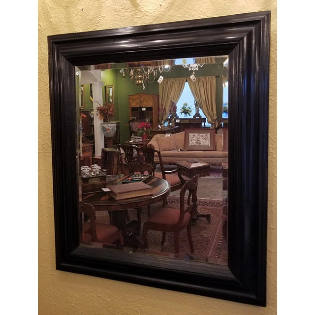 Presenting a stunning mid-late 19th century American ebony mirror with bevelled glass. From circa 1860-1880. This...