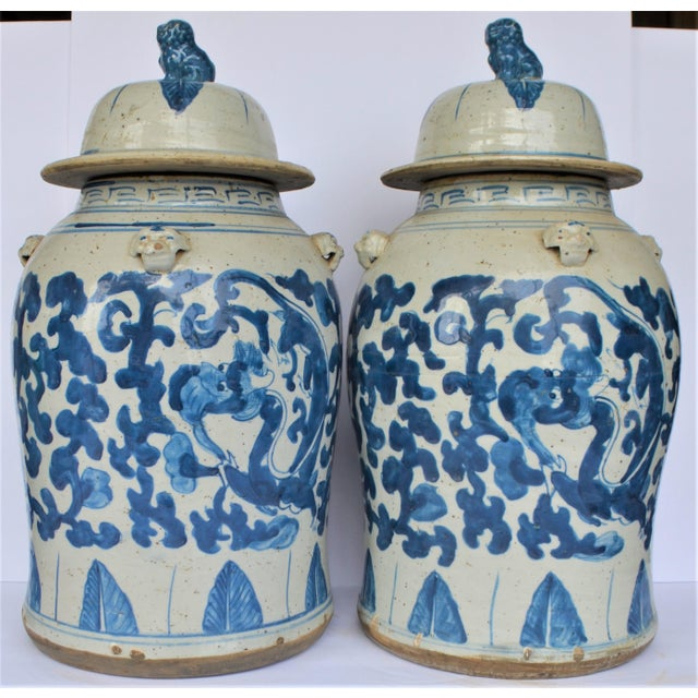 This is a pair of large, high quality porcelain blue and white Balaster Temple Jar / Ginger Jar decorated with a leaf and...