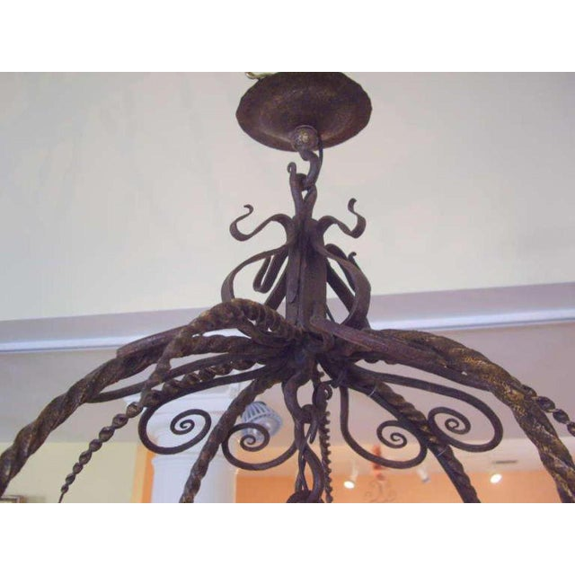Unusual Provincial Wrought Iron 12-Light Chandelier For Sale - Image 4 of 9