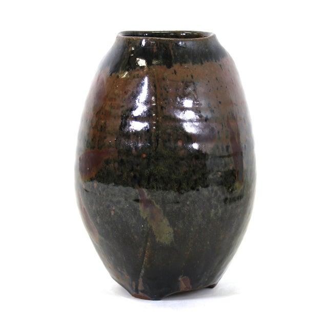 Japanese Mid-Century Modern art studio pottery vase with luster glaze on diminutive tripod legs