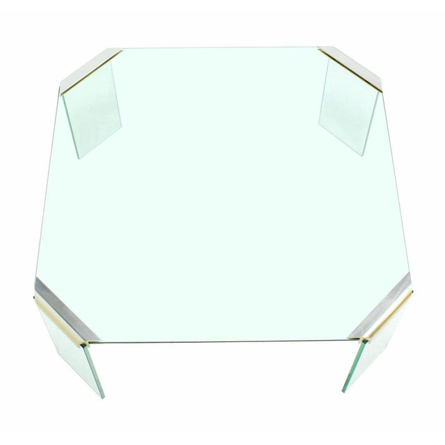 Square glass coffee table.