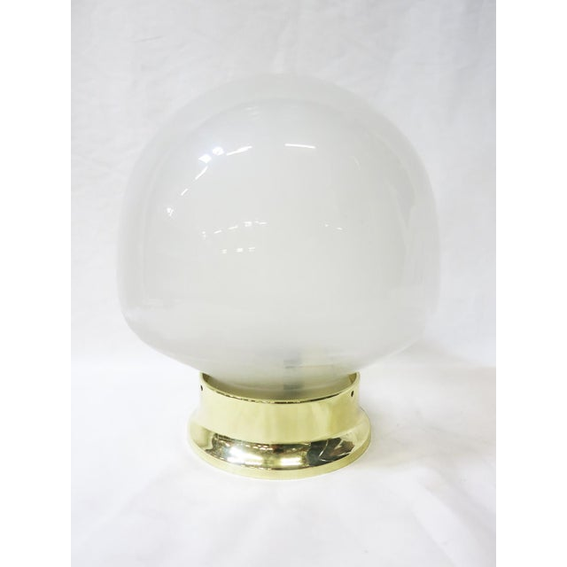 "Brighten your living space with our vintage glass globe that features a unique ""gumdrop"" shape. Available with a new Brass..."