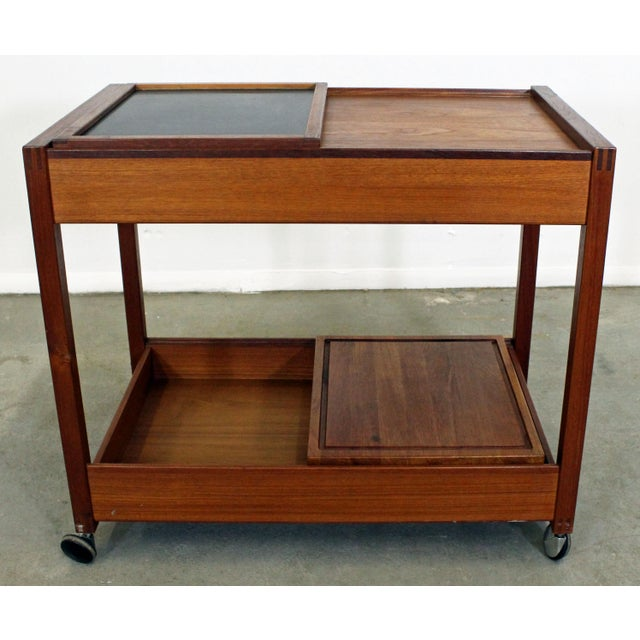 What a find. Offered is a very cool Danish Modern teak bar cart. Features two sliding doors on top and bottom with...