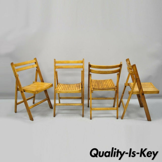 4 Vintage Wood Slat Seat Mid Century Modern Folding Dining Game Chairs. Item features wood slat seats, (4) folding chairs,...