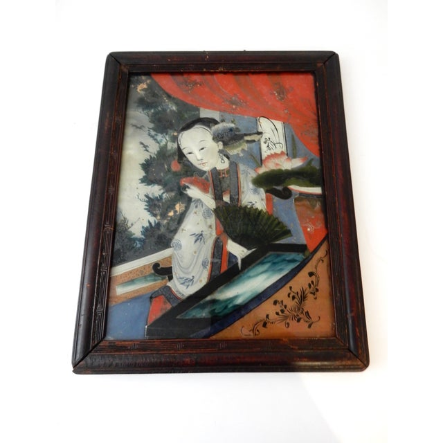 Superb antique reverse glass painting of a young Asian lady.... painting on glass is an art form consisting of applying...