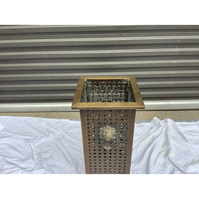 Handsome square umbrella stand, made of brass with a copper liner basket. Lion pull accents on 2 sides, with brass ball...