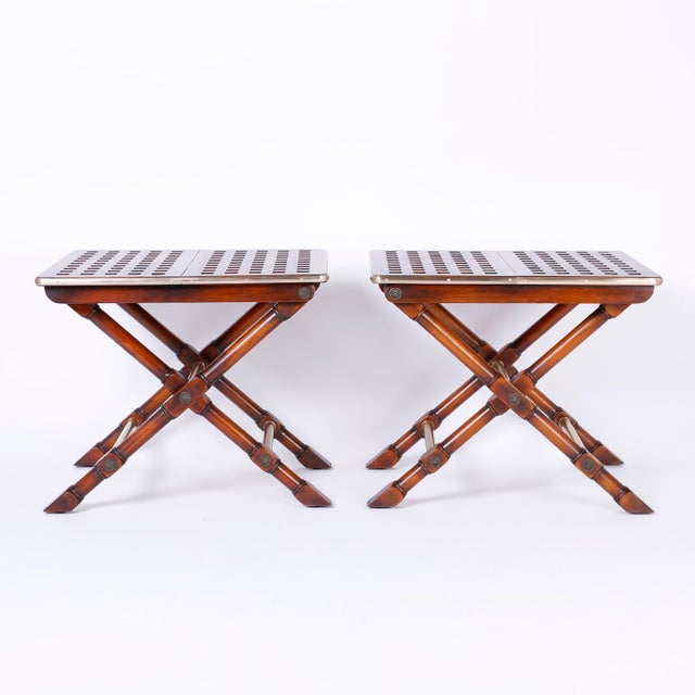 Unusual and fine pair of mahogany tables featuring criss cross construction on top banded with thick brass, X style turned...