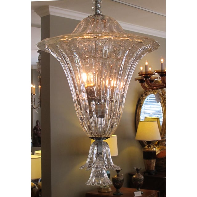 bullicante glass lantern/pendant light made in Venice by Seguso having a twisted central shaft above a domed lid over a...