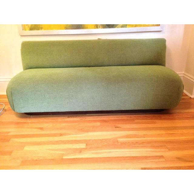 We had a San Francisco/Washington D.C. decorator design this custom made couch for our sun room. The couch was...