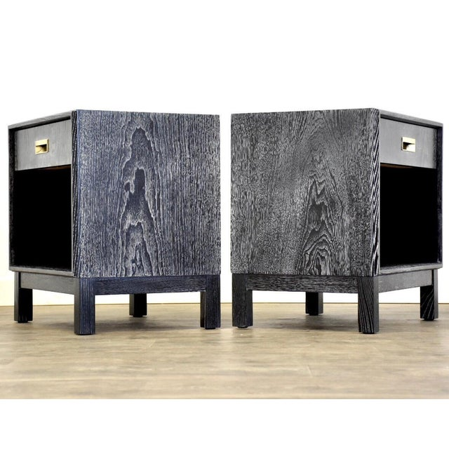 A pair of mid century modern black lacquer cerused ash nightstand bedside tables with a single drawer and lower shelf....