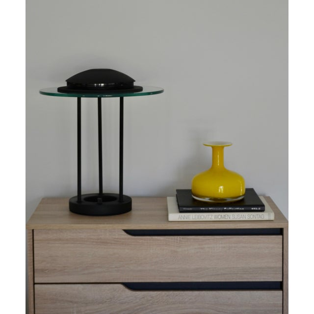 Striking Postmodern matte black table lamp, circa 1980s. This sculptural lamp is designed of lacquered metal with a sleek...