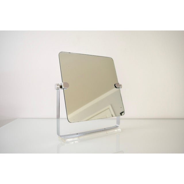 • Vintage mid century modern chrome and lucite table top mirror circa 1970. • Classic minimalist style with clean...