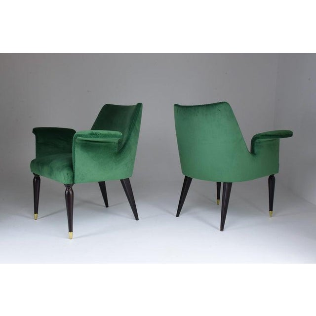A set of two midcentury armchairs, circa 1940s. These have been expertly restored, through new finish and re-upholstered...