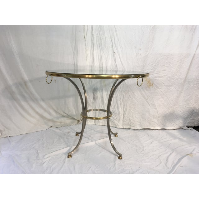 Unlacquered brass & steel Directoire style table, in the style of Jansen. Very little wear to steel or brass, but some...
