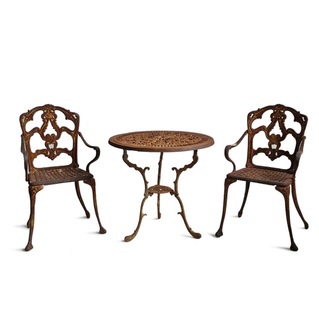 Vintage French style cast iron bistro set of three. Beautiful pieces for your outdoor garden or patio. The round table...