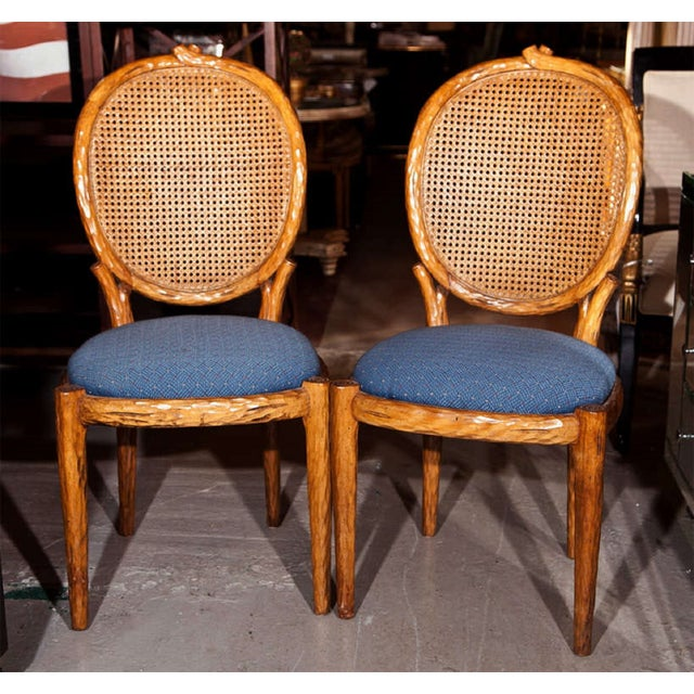 Offered is a pair of French Louis XIV style side chairs, each with oval caned backs and blue upholstered padded seats. The...