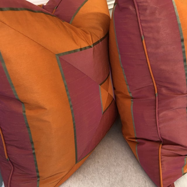 """Custom pair of 22"""" pillows covered in a silk stripe fabric that is mitered. Pillows are self welted, have feather/down..."""