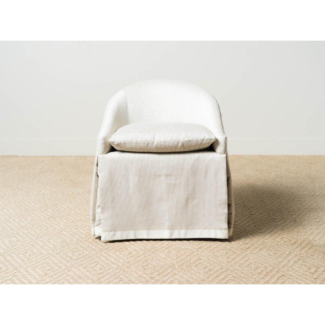 Side chair tight upholstered in polyester blend. Blend: 86% polyester, 4% flax Contrasting band on skirt. MicroSeal stain...