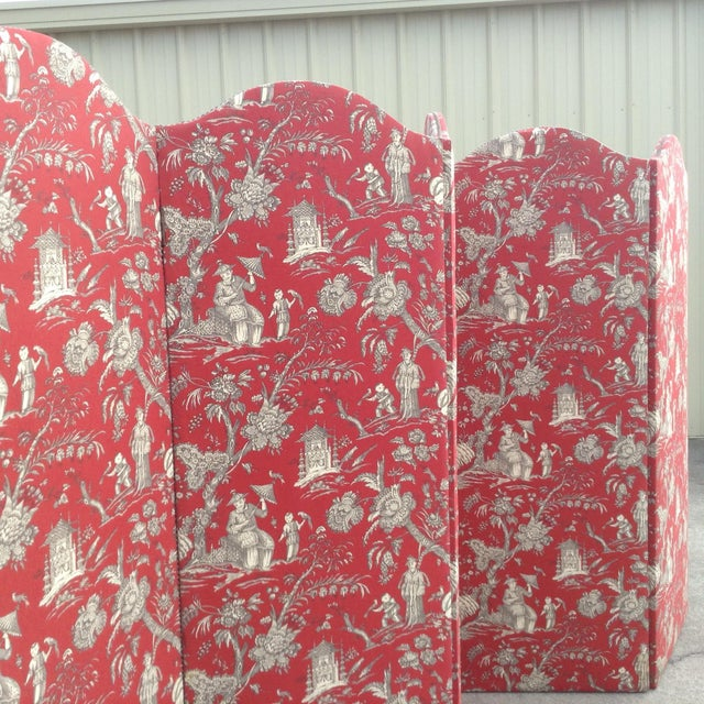 Original French five panel screen to use as accent or room divider. Each panel is covered with red toile fabric and brass...