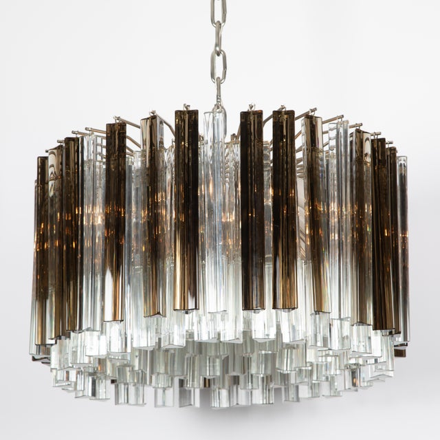 1970s Italian prism chandelier consisting of eight rings of tightly spaced triangular crystals of two different lengths in...