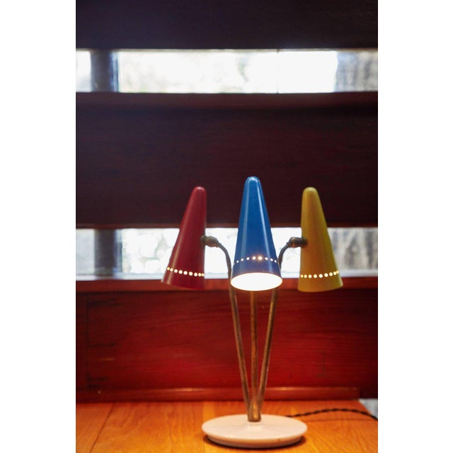 Rare 1950s Arteluce Tricolore table lamp. This extremely rare and iconic design executed in painted metal, brass and...