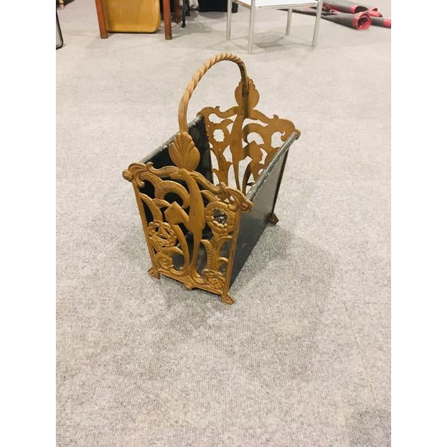 This magazine rack is a beautiful example of Art Deco decor. The ends are cast iron, while the middle section is made of...