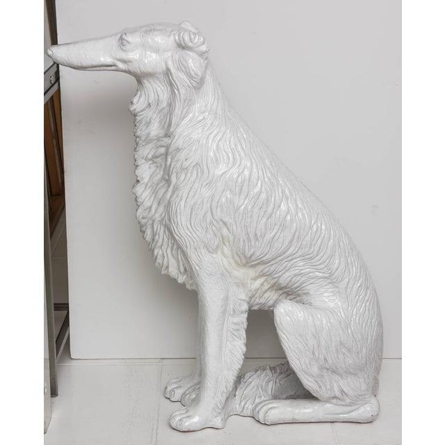 "Life-sized Russian wolfhound in white glazed terracotta. Made in Italy. Gleaming, life-sized, signed ""Made in Italy""..."