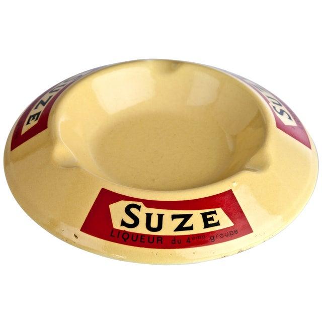 Vintage porcelain ashtray advertising Suze Liqueur. Imported from France.