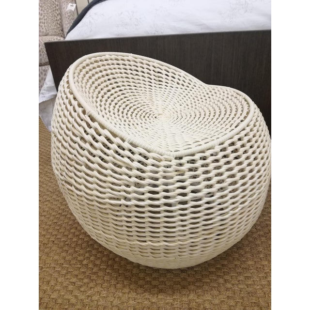 Powder-coated metal frame is intricately hand-woven with white all-weather synthetic wicker. Stool comes with a 360 degree...
