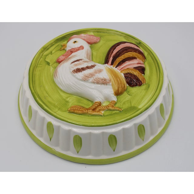 A stunning vintage French Country style ceramic rooster mold. The colors are bright, with an eye catching design. The...