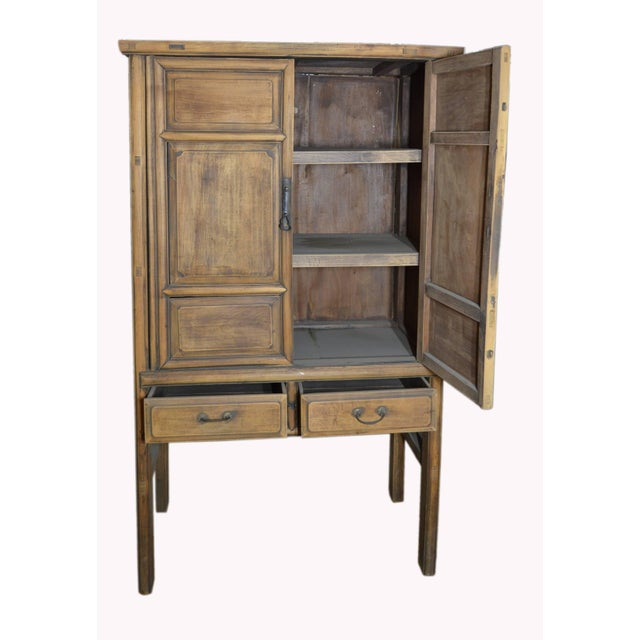 19th Century Chinese Wooden Wardrobe With Paneled Doors, Drawers and Tall Legs For Sale - Image 4 of 8