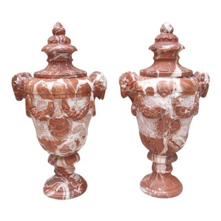 Pair of Antique French Vases Aux Beliers in Carved Rouge Marble For Sale