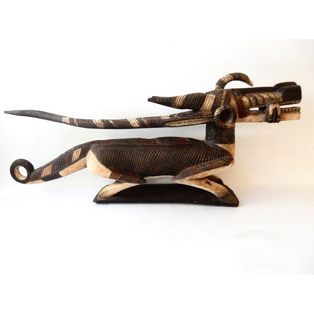 Superb huge Chiwara (antelope) carved of one piece of wood sculpture. Used in ritual by the initiation society associated...