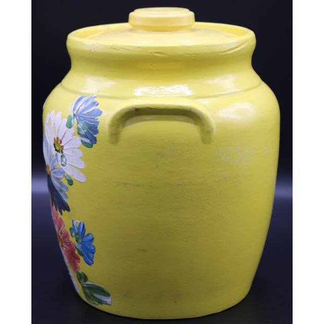 This is a Yellow Floral Ransburg Pottery Jar with Lid, circa 1930. Use it for cookies, flour, coffee, or an arrangement of...