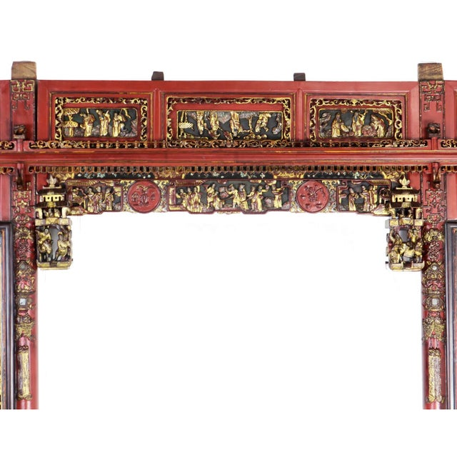 A beautiful and intricately detailed set of panels and carvings that make up the front of a Chinese wedding bed. We are...