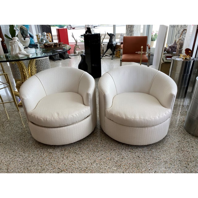 These stylish, low profile swivel club chairs date to the 1970s and have been professionally reupholstered (June 2020) in...