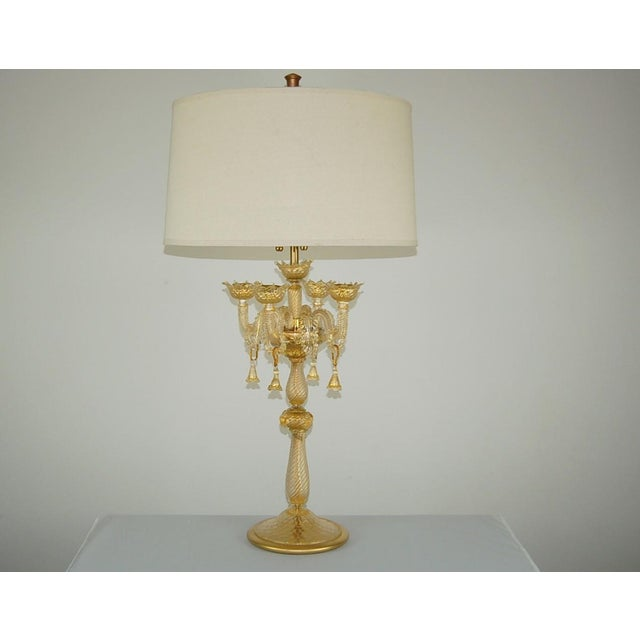 Spectacular pair of vintage Murano candelabra glass table lamps in CHAMPAGNE GOLD, 1960. These lamps are gorgeous! In all...