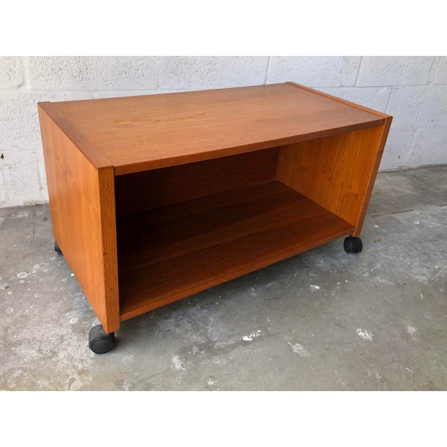 Vintage Mid-Century Danish Modern Teak Tv Stand/Media Cabinet/ Printer Cart on Casters Features a minimalist Scandinavian...