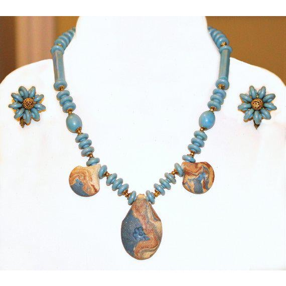 Miriam Haskell light blue molded bead necklace and earrings with goldtone metal findings and filigree beads. It is...