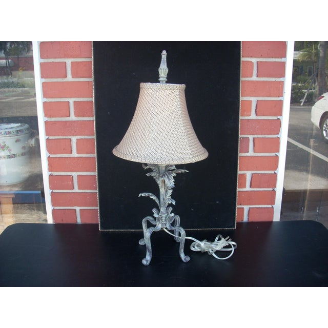 French country table lamp with dark metal base and antiqued gray wash for an aged look. The shade is lined in white...
