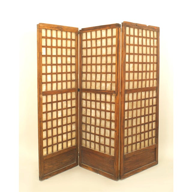 Italian mid-century three-panel screen with a square panels of abalone shells in a rustic wood frame (each pane measure...