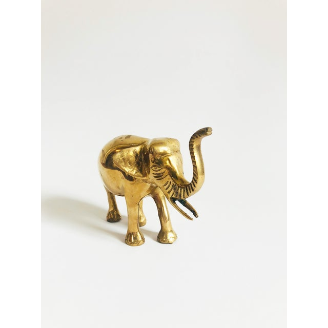 A wonderful vintage brass elephant with a trunk up for good luck.
