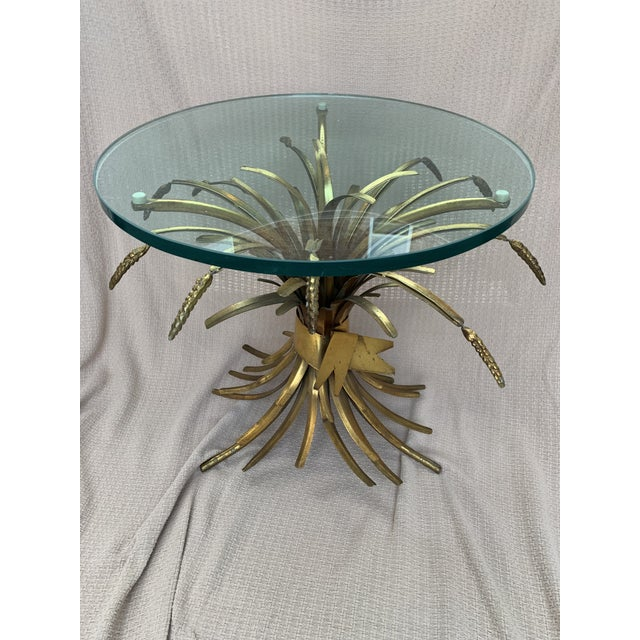 Vintage gold gilt tole wheat sheaf glass top side cocktail table. Please keep in mind this is a vintage piece and has its...