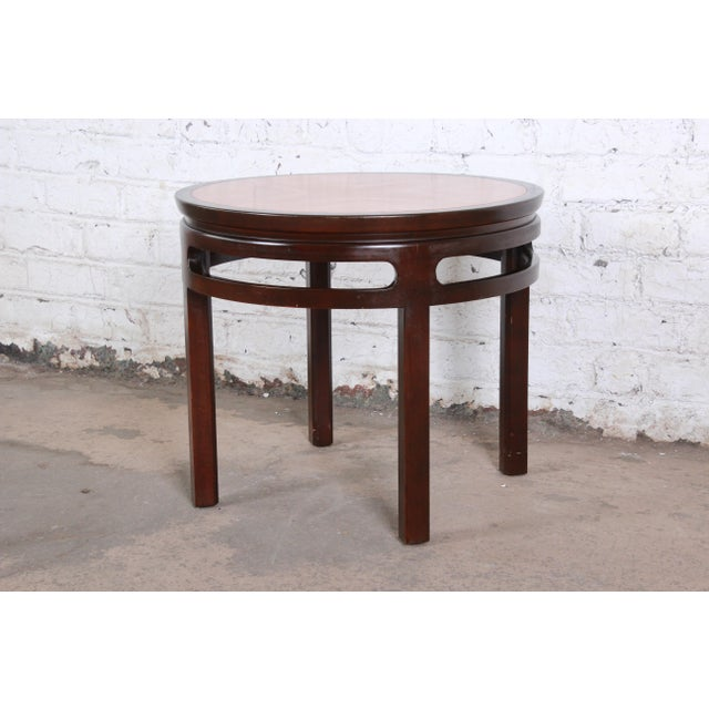 A gorgeous mid-century Hollywood Regency Chinoiserie end table by Michael Taylor for Baker Furniture. The table features...