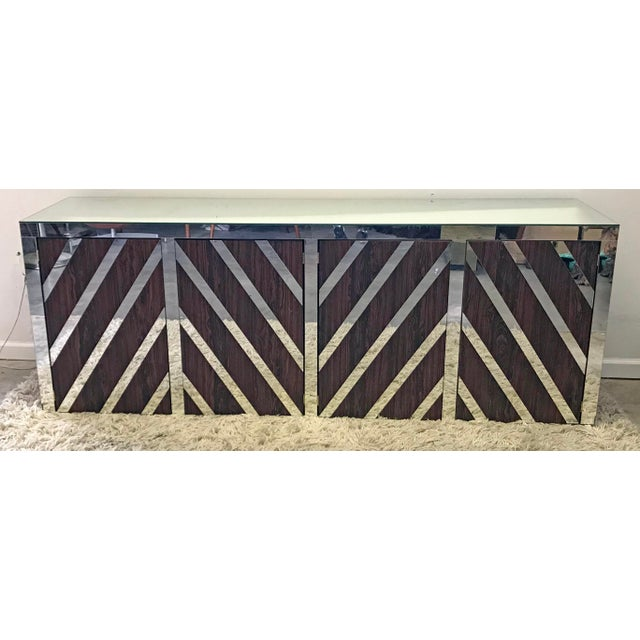 An absolutely stunning rosewood veneer and mirrored credenza from the 1970's.