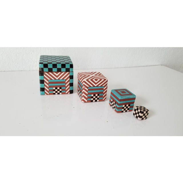 This is a beautiful Vintage / Postmodern artistic handmade decorative pottery boxes set of 4 . Featuring , stacking design...